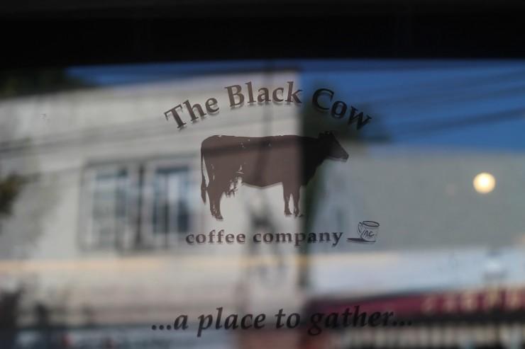 black cow coffee shop door