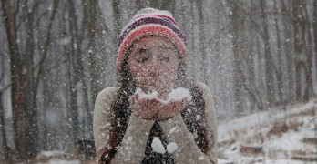 Girl blowing snow poetic voices relationships