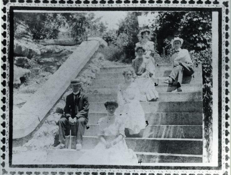People seated on gazebo stairs - Eureka Springs Carnegie Library historic photo