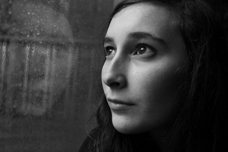 Girl reflection in window - British Poet Laureate Carol Ann Duffy