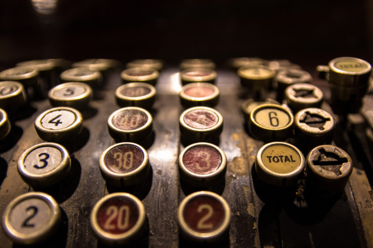 Vintage cash register top tax day haiku