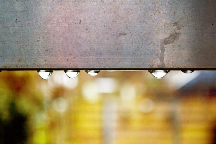 water droplets on metal beam
