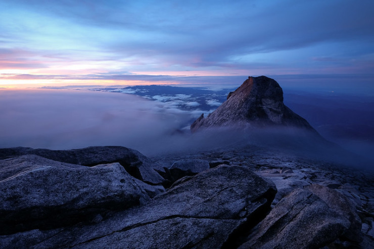 Pandemic Journal - photo of Mt. Kinabalu above misty clouds