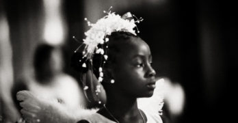 Black girl dressed as angel