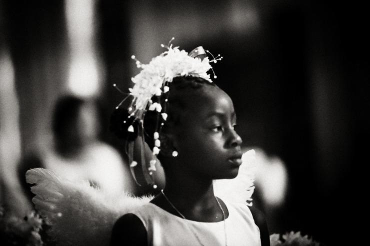 Black girl dressed as angel
