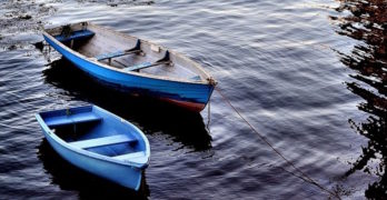 two-blue-boats-on-river